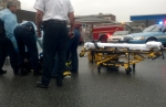 Police and paramedics prepare to load the victim of the Wednesday's shooting in the University District Safeway's parking lot onto a stretcher for transport to Harborview Medical Center. The victim appeared to be receiving treatment for an injury near his abdomen, and is currently in critical condition, according to police.