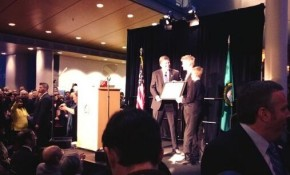Seattle City Councilmember Mike O'Brien, taking the oath of office from his two sons in January 2014. Next November, O'Brien and his fellow counterparts will have choose between seeking reelection in their district or for one of two city-wide seats.